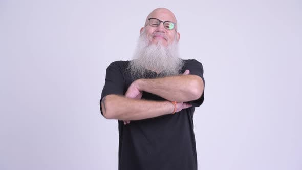 Thumbnail for Happy Mature Bald Bearded Man Smiling with Arms Crossed