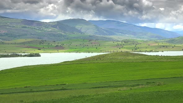 Thumbnail for Bright Green Meadows and Fields Around The Lake