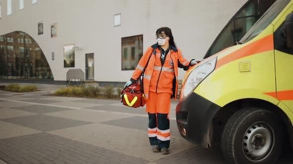 Establishing Shot Paramedic Stands Near Ambulance