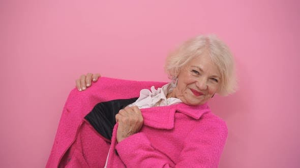 an Optimistic Pensioner Does Not Think About Her Age, Old Age. A Woman with Blonde Hair in a
