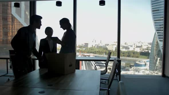 Several Silhouettes of Attractive Handsome Businesspeople Interacting Business Center.