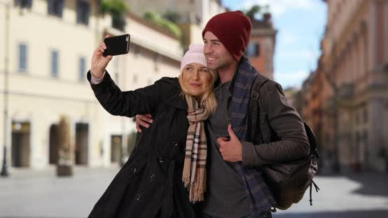 Thumbnail for Happy young couple taking a selfie in Rome with smartphone