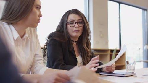 Businesswomen talking at a meeting