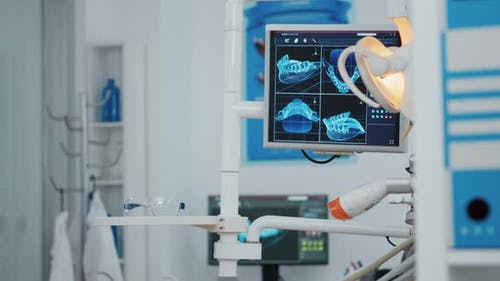 Close Up of Medical Orthodontist Display with x Ray Images on It