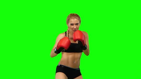 Thumbnail for Boxer Standing in the Front and Sends Butted an Opponent Standing on the Spot. Green Screen. Close