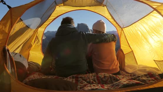 Thumbnail for The View From Inside the Tent on a Couple Watching the Mountain Landscape of Yosemite Park at a Dawn