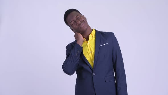 Thumbnail for Young Stressed African Businessman Having Neck Pain