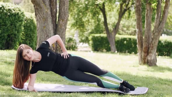 Thumbnail for The Athletic Woman Is Doing Morning Gymnastics Outdoors