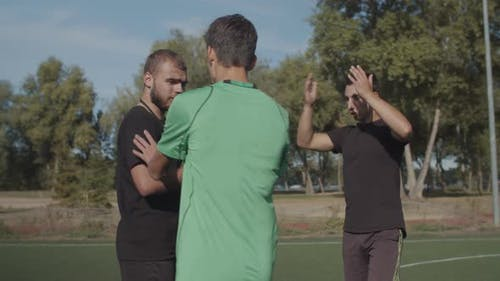 Soccer Team Arguing with Referee for Dismissal