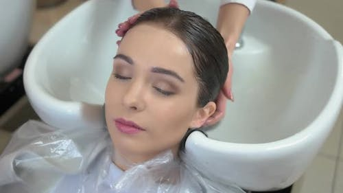Woman Getting Her Head Washed