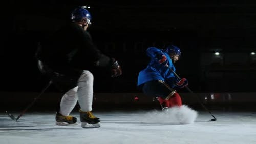 Two Man Playing Hockey on Ice Rink. Hockey Two Hockey Players Fighting for Puck