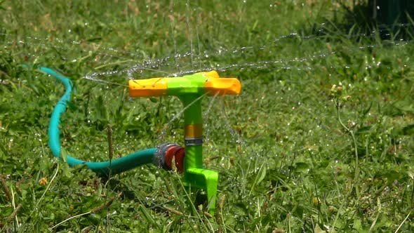 Thumbnail for Sprinkler Irrigation Water on Grass