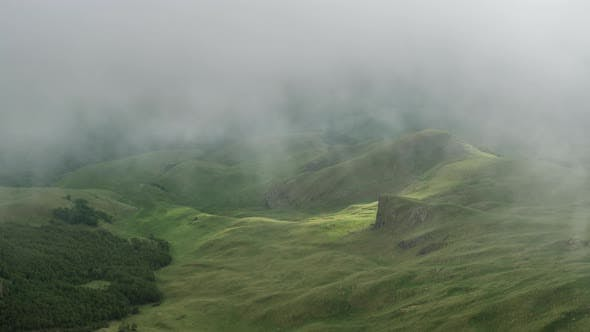 Thumbnail for Mountain valley covered in fog clouds.