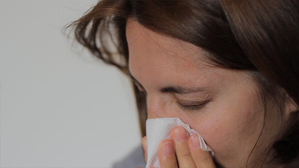 Thumbnail for Woman is Blowing Nose