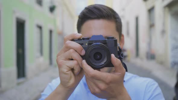 Cover Image for Smiling Stylish Photographer with Piercing Looking at Camera