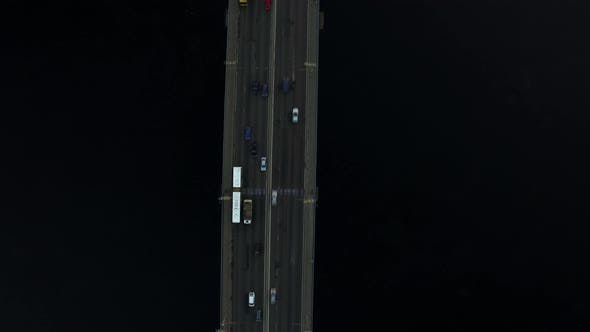 Thumbnail for Car Driving on Highway Bridge Over River. Top View Car Traffic on River Bridge