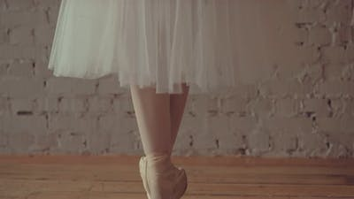 Dancer in Pointes Trains the Movements of the Legs and Arms