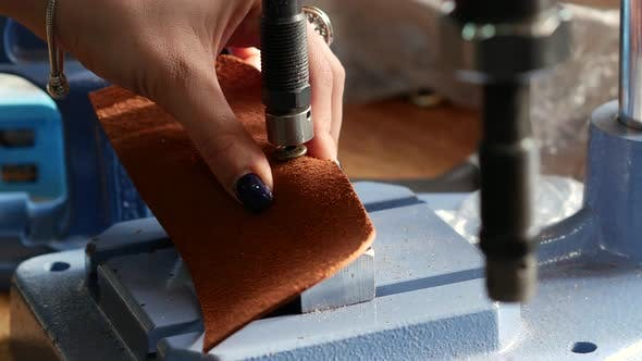 Thumbnail for Female Craftsman Using Press for Installing Metal Rivet on Geniune Leather Product. Close Up