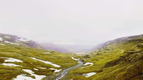 Panoramic Wallpaper View of Mountainous Snowy Peaks and a Narrow River