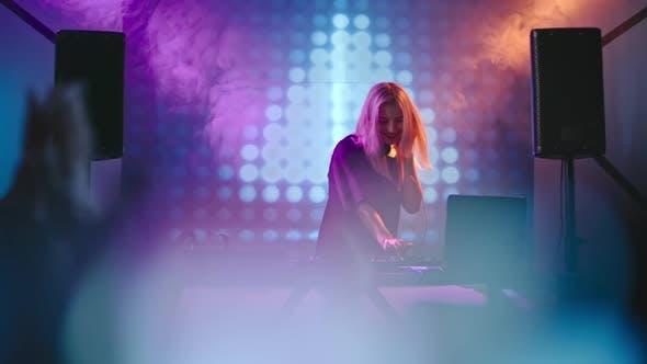 Thumbnail for Female DJ Dancing Behind Decks