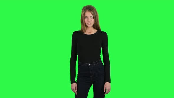 Cover Image for Young Woman Smiling and Posing at the Camera. Green Screen
