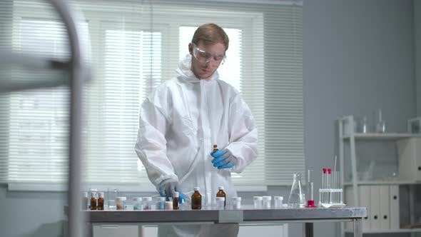 Thumbnail for Man in Protective Workwear and Gloves Work with Chemical Equipment in the Laboratory
