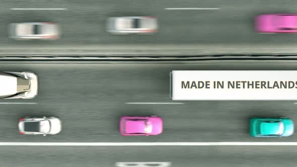 Trucks with MADE IN NETHERLANDS Text Driving Along the Road