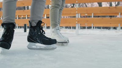 Legs In Skates Skating On Rink