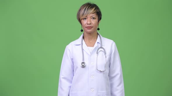 Cover Image for Happy Mature Beautiful Multi-ethnic Woman Doctor