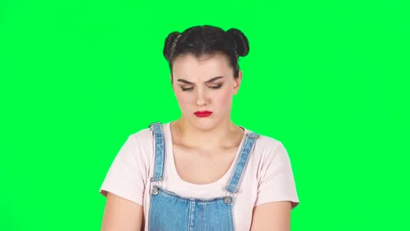 Thumbnail for Cute Female Feels Bad, Her Stomach Hurts, Feeling Nausea on Green Screen at Studio, Slow Motion