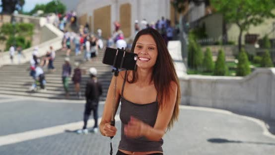 Thumbnail for Cute millennial girl vacationing Rome taking silly selfies by the Spanish Steps