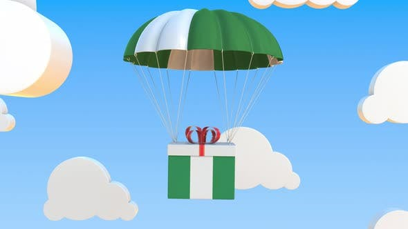 Box with Flag of Nigeria Falls with a Parachute