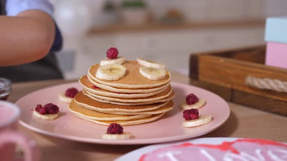 Thumbnail for Closeup Pancake Heap Decorating By Child's Hand