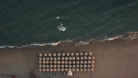 Thumbnail for Flying Over Seaside with Chaise Longues Under Straw Umbrellas