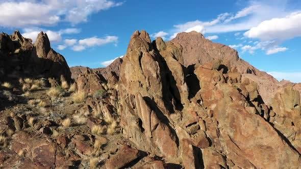 Panning aerial view of rocky desert landscape in Utah