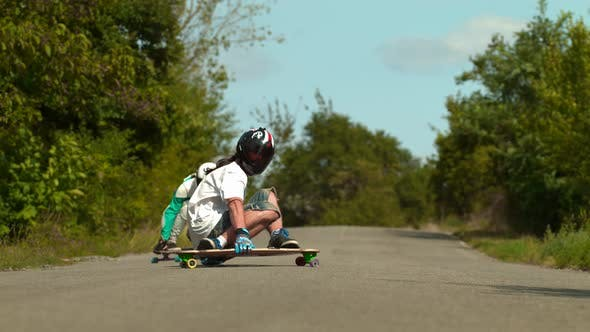 Thumbnail for Two longboarders on the road, slow motion