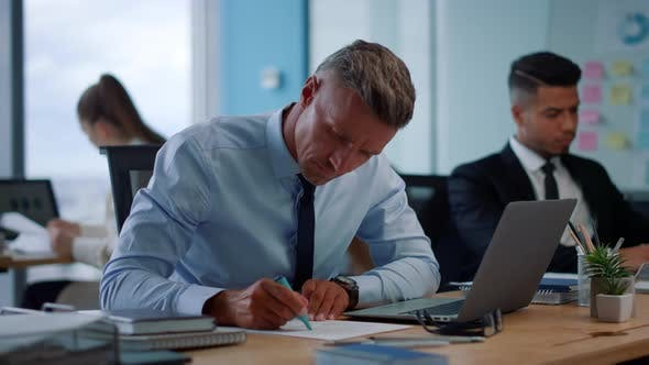 Thumbnail for Displeased Businessman Using Laptop, Male Manager Working with Documents
