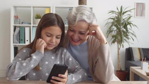 Caucasian Grandmother and Grandchild Using Smartphone