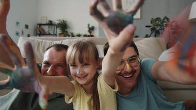 Family With Paint On Hands