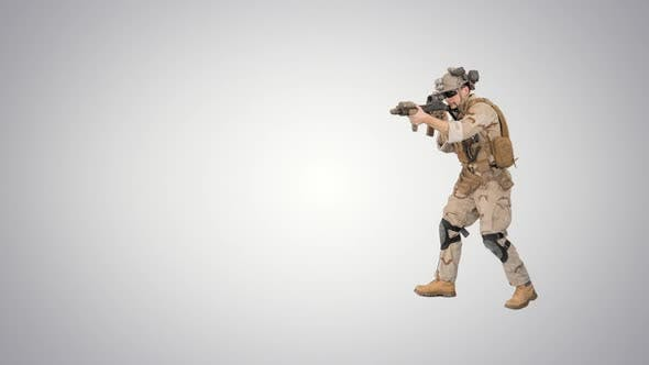 Armed Marine Soldier with Assault Rifle Walking By Aiming on Gradient Background