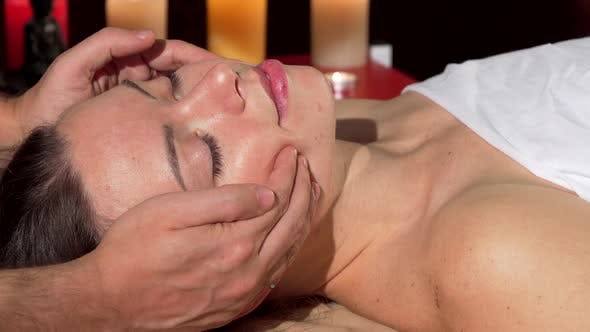Thumbnail for Lovely Young Woman Enjoying Face Massage with Her Eyes Closed