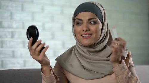Arab Housewife Applying Lip Gloss