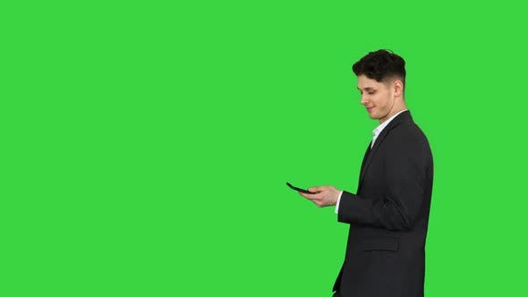 Thumbnail for Happy Successful Businessman Dancing Listening Music From the Phone And Walking on a Green Screen