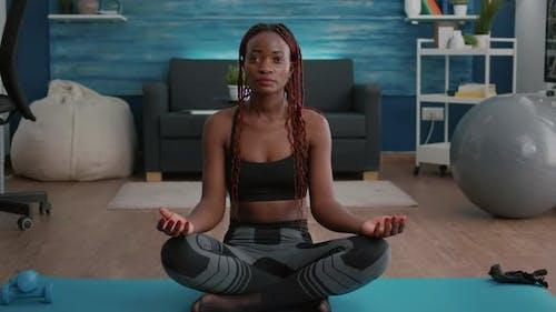Flexible Flexible Athlete Woman Relaxing in Lotus Position on Floor