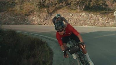 Professional Cyclists Take Sharp Corner of Road