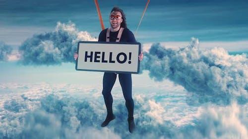 Cheerful Male Parachutist with Hello Inscription