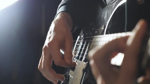 Thumbnail for Hands of Guy Performing Solo of Rock Music. Close Up Arms of Musician Playing on Electric Guitar