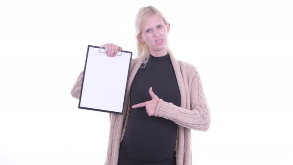 Thumbnail for Stressed Young Blonde Pregnant Woman Showing Clipboard and Giving Thumbs Down
