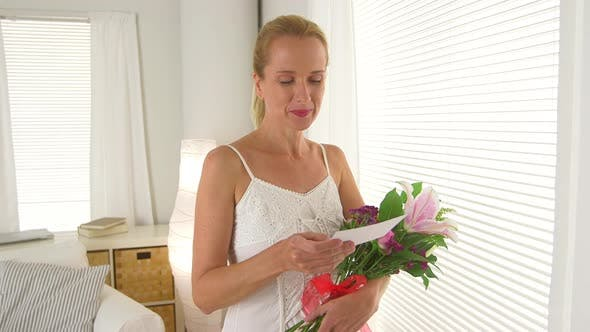 Thumbnail for Mature woman with bouquet of flowers and a love letter