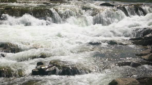 Waterfall Flow Over Rocks in the River